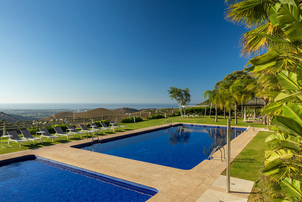 Outdoor swimming pool with Mediterranean views in Benahavis Hills