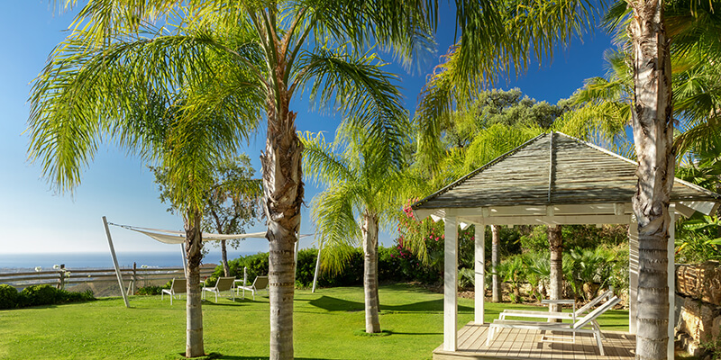 Gazebo by the outdoor pool at Benahavis hills Country Club where you can enjoy spectacular views of the Mediterranean