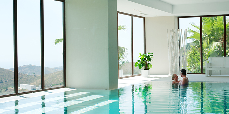 Indoor pool with views over Benahavis and Mediterranean coastline