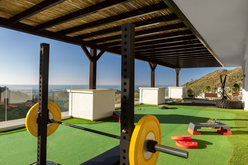 Gym and fitness facilities in Benahavis with views over Mediterranean coastline